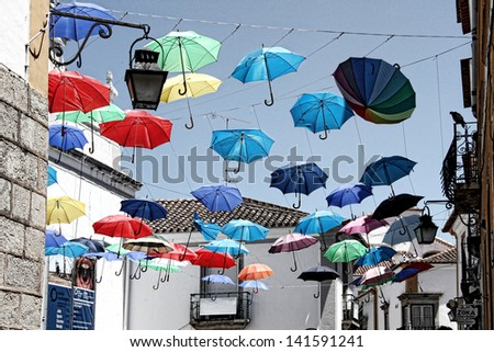 Ã?Â??vora, Portugal umbrella different colors - stock photo