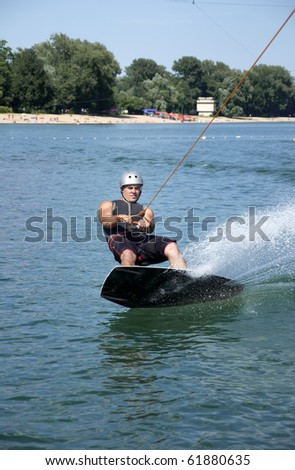 Wake boarder riding - stock photo