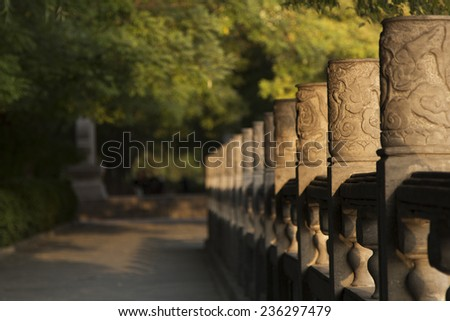 walkway in shade at sunset  - stock photo