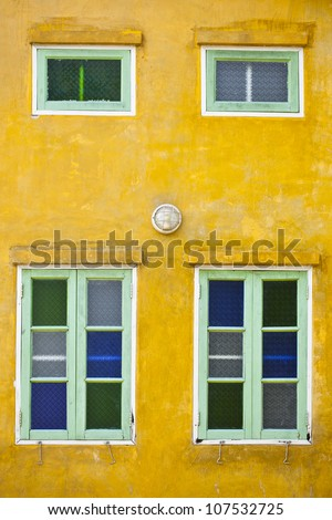 Wall and window of rustic cottage - stock photo