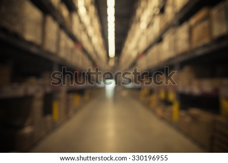 warehouse with many layer shelves with blur focus - stock photo