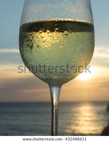 Watching the sunset with a glass of wine - views around Curacao a Caribbean island