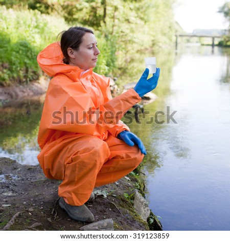 water sampling and analysis in a river - stock photo