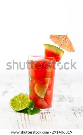 Watermelon mojito with watermelon garnish, fresh juice - stock photo