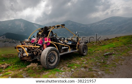 4wd buggy for extreme off-road shot on mountain - stock photo