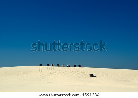 4WD Driving in Sand Dunes - stock photo