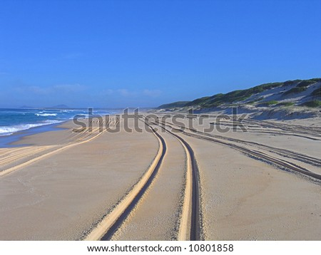 4WD track on a beach - stock photo