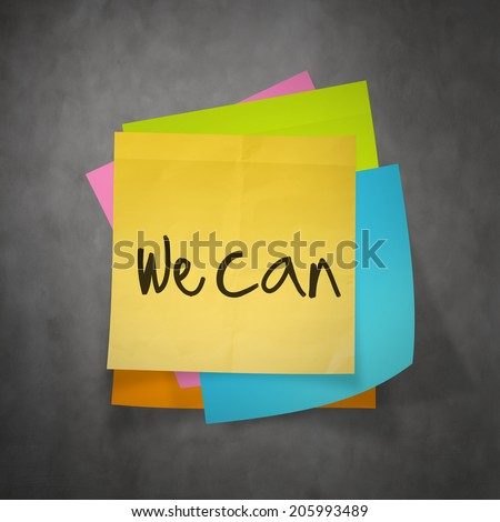 """""""we can"""" text on sticky note paper on wall texture - stock photo"""
