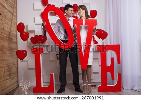 Wedding beautiful couple in love hold large love letters - stock photo