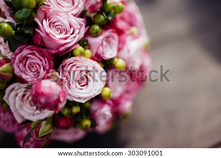 Wedding bouquet of bride - colorful flowers. close up of wedding bouquet