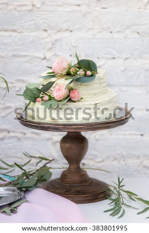 wedding cake decorated with flowers - stock photo