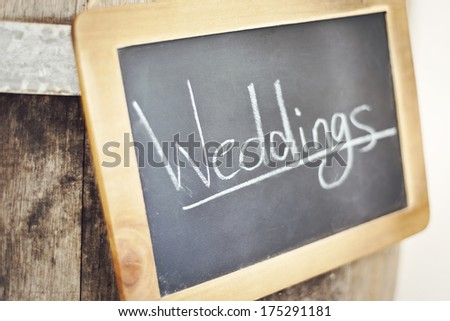 """weddings' handwritten sign at a function centre - stock photo"