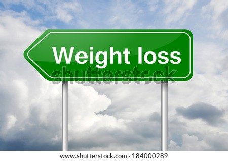 ":Weight loss"" arrow green sign post - stock photo"