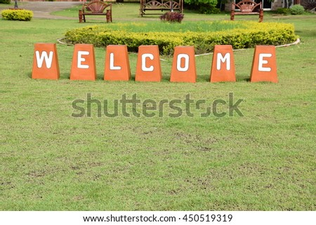 Welcome sign Decoration on green grass in park