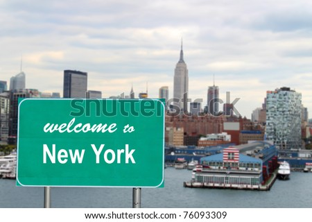 Welcome to New York sign with famous skyline and boat docks along the Hudson River - stock photo