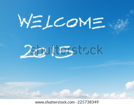 """welcome 2015"" written in the sky with contrails left by airplane - stock photo"