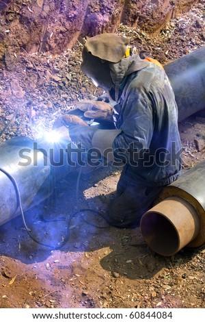 Welder  repair   pipeline - stock photo