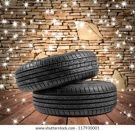 wheel rubber gift for Christmas  on the wood textured backgrounds in a room interior - stock photo