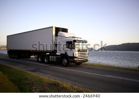 18 wheeler traveling in the countryside - stock photo