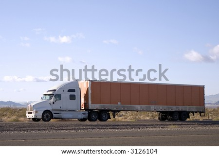 18-Wheeler Traveling on an Interstate - stock photo