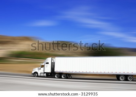 18 wheeler traveling on the highway - stock photo
