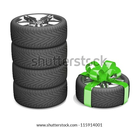 4 wheels and 5 as a gift. A tyre with a green ribbon like a present isolated on white background - stock photo