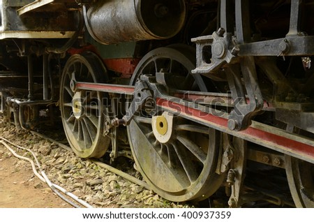 Wheels of vintage steam locomotive - stock photo