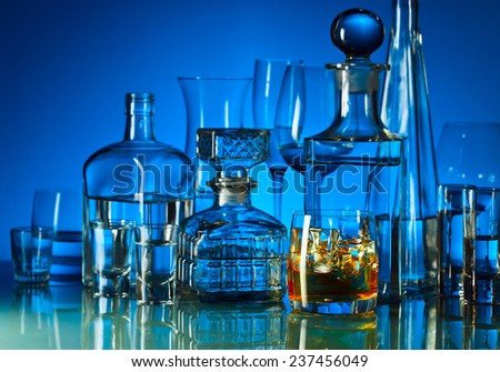 whiskey and ice in bar on glass table  - stock photo