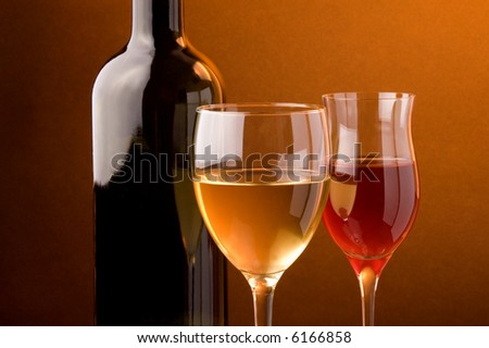 white  and red glass of wine bottle details - stock photo
