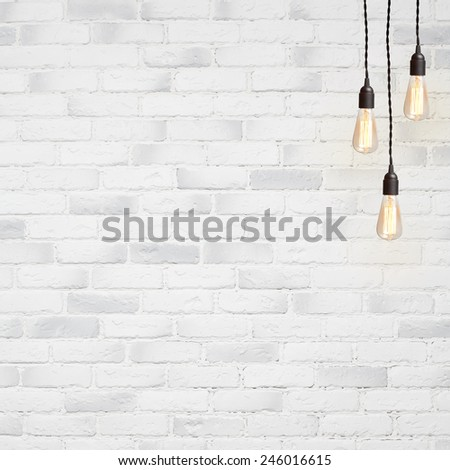white brick wall background with retro lamp - stock photo