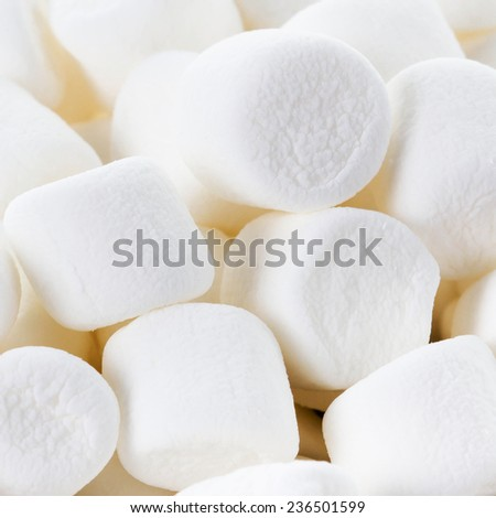 White Fluffy Round Marshmallows as a background. Sweet  Food Candy Background as poster. wallpaper, backdrop macro