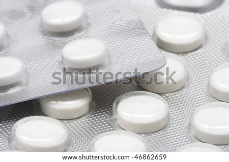 white pills in blisters close up