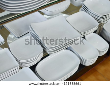 white plates in a shop - stock photo