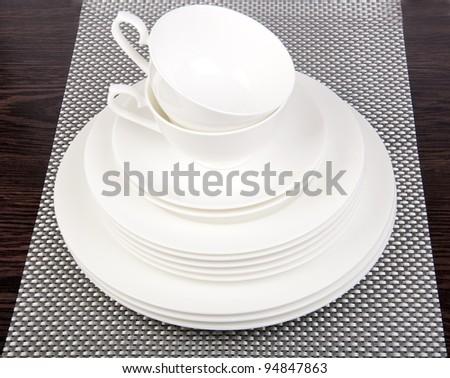 White porcelain plates  and saucers - stock photo
