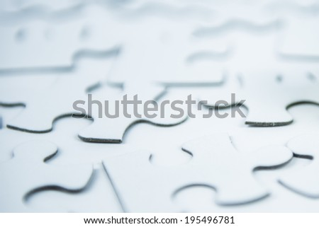 white puzzle, blurred - stock photo