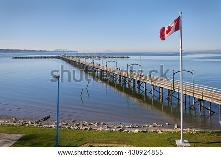 White Rock Pier BC, Canada. White Rock and it's pier is a popular tourist destination on the west coast of British Columbia near the United States border.                          - stock photo