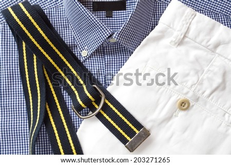 White short pants with shirt and belt - stock photo