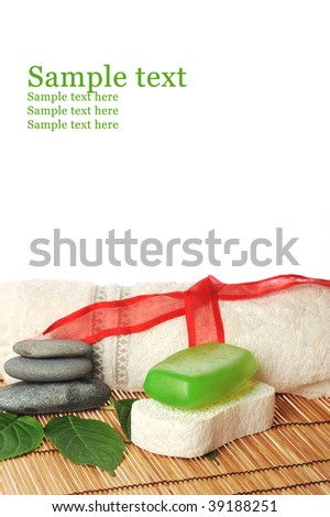 white towel and green soap lie on  table