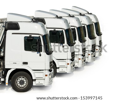 White trucks parked, aligned and isolated on white - stock photo