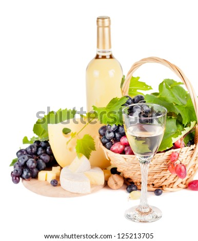 White wine by the glass and a variety of cheeses - stock photo