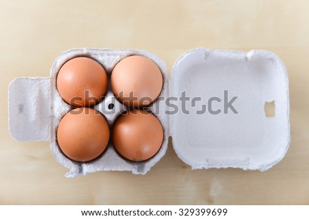 4 whole eggs in egg packaging
