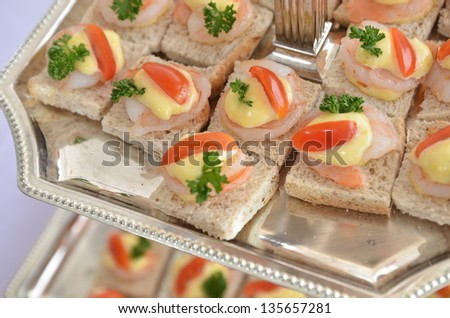 whole wheat sandwich with shrimp on top - stock photo