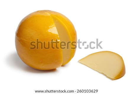 Whole yellow round Edam cheese with a slice on white background - stock photo