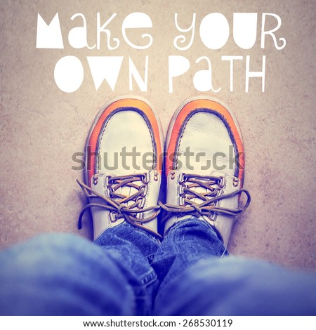 wide angle overhead shot of yellow and white boat or deck shoes with a text quote make your own path toned with a retro vintage instagram filter effect app or action  - stock photo