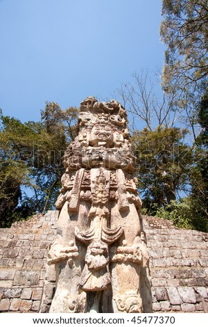Wide angle view of Stela D portraying 'King 18 Rabbit' at the ancient Mayan ruins of Copan. This stela depicts the 13th king of Copan. Honduras, Central America. - stock photo