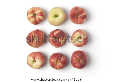 Wild flat peaches isolated  on white background