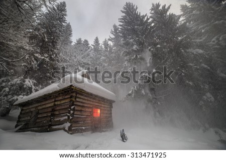 wild forest, among the legendary mountains of Eastern Europe Ukraine- are houses of shepherds and hunters, covered with snow, where tourists rarely come travelers climbers to the top of Montenegro - stock photo