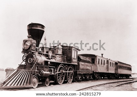 'William Crooks' a 1861 locomotive of the Great Northern Railway with tender and cars. The tender is a special car to carry fuel and water to keep the locomotive running. - stock photo