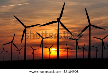 Wind power landscape at sunset - stock photo
