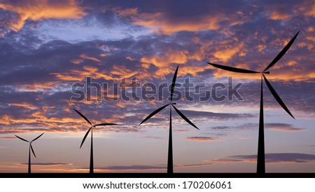 Wind turbine silhouette sunset or sunrise economic system background